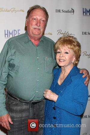 Jeffrey Jones and Debbie Reynolds