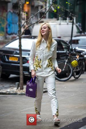 Elle Fanning - Elle Fanning returns to her hotel wearing white shirt and pants with a floral print - New...