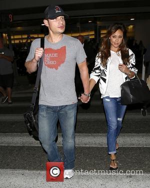 Nick Lachey and Vanessa Minnillo - Nick Lachey and Vanessa Minnillo arrive at LAX - Los Angeles, California, United States...