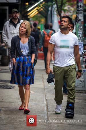 Kelly Ripa and Mark Consuelos - Kelly Ripa and Mark Consuelos were all smiles in spite of wet weather as...