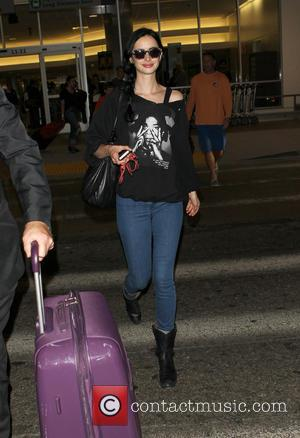Krysten Ritter - Krysten Ritter arriving at Los Angeles International (LAX) Airport - Los Angeles, California, United States - Friday...
