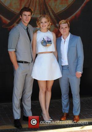 Liam Hemsworth, Jennifer Lawrence, Sam Claflin and Donald Sutherland - The 67th Annual Cannes Film Festival - 'The Hunger Games:...