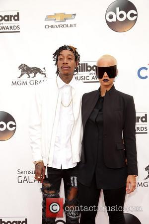 Wiz Khalifa and Amber Rose - Celebrities attend 2014 Billboard Music Awards - Arrivals at MGM Grand Garden Arena in...