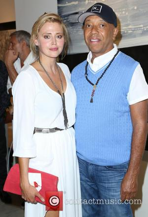 Estella Warren and Russell Simmon