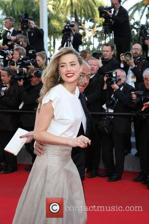 Amber Heard - The 67th Annual Cannes Film Festival - 'Two Days, One Night' (Deux Jours, Une Nuit) - Premiere...