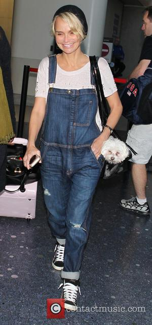 Kristin Chenoweth - Kristin Chenoweth at Los Angeles International Airport (LAX) carrying her pet dog in her shoulder bag -...