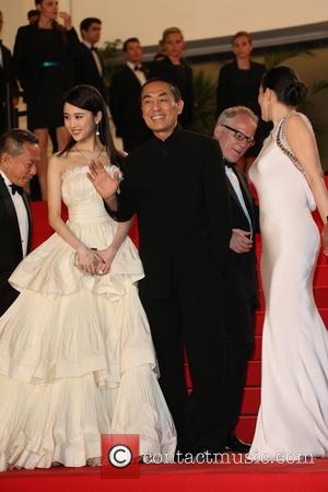 Huiwen Zhang (l), Gong Li (r) and director Zhang Yimou - The 67th Annual Cannes Film Festival - Coming Home...