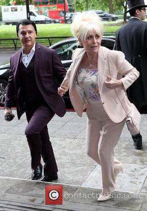 Barbara Windsor and Scott Mitchell - The 2014 Ivor Novello Awards at the Grosvenor House Hotel - London, United Kingdom...