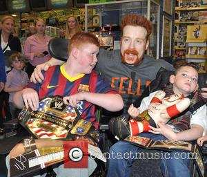 Sheamus, Sean Rooney and Leo Conway - Irish WWE wrestling star Sheamus meeting fans at smyths toystore on Jervis St....