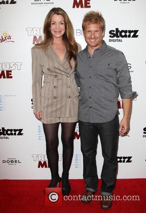 Claudia Christian and Adam Schomer
