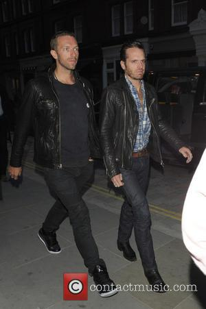 Chris Martin and Guy Berryman - Emily Blunt and Jeremy Renner among celebrities spotted at Chiltern Firehouse - London, United...