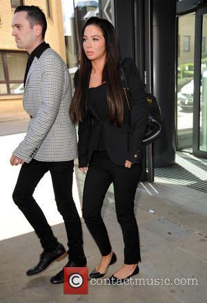 Tulisa Contostavlos, Gareth Varey, black suit and looking upset - Tulisa pictured leaving Chelmsford Magistrates Court - London, United Kingdom...