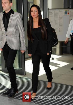 Tulisa Contostavlos, Gareth Varey, black suit and looking upset