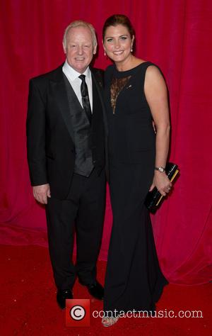 Les Dennis and Claire Nicholson - The British Soap Awards 2014 held at Hackney Empire - Arrivals - London, United...