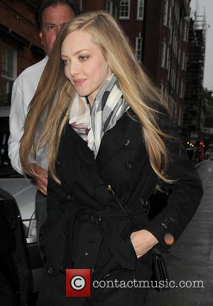 Amanda Seyfried - Amanda Seyfried signs autographs for fans as she leaves Claridge's hotel - London, United Kingdom - Monday...