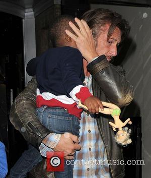 Sean Penn and Jackson Theron - Charlize Theron and Sean Penn leaving Claridge's hotel with Theron's son Jackson - London,...