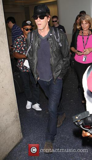 Kevin Bacon - Kevin Bacon arrives at Los Angeles International (LAX) airport - Los Angeles, California, United States - Monday...