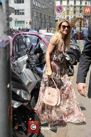 Michelle Hunziker - Michelle Hunziker arrives home wearing a floral maxi dress - Milan, Italy - Tuesday 27th May 2014