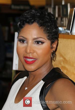 Toni Braxton - Toni Braxton signs copies of her book 'Unbreak My Heart: A Memoir' at Barnes & Noble at...