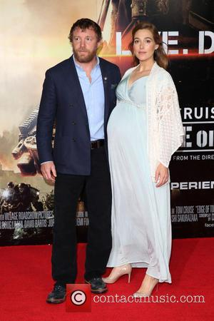 Guy Ritchie and Jacqui Ainsley - World premiere of 'Edge Of Tomorrow' held at the BFI IMAX - Arrivals -...