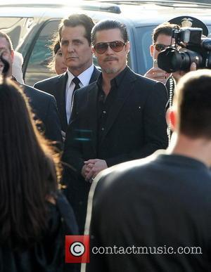 Brad Pitt - Brad Pitt and partner Angelina Jolie arriving for the world premiere of