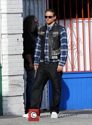 Charlie Hunnam - Charlie Hunnam hops on his bike on the set of