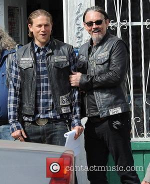Charlie Hunnam and Tommy Flanagan - Charlie Hunnam hops on his bike on the set of