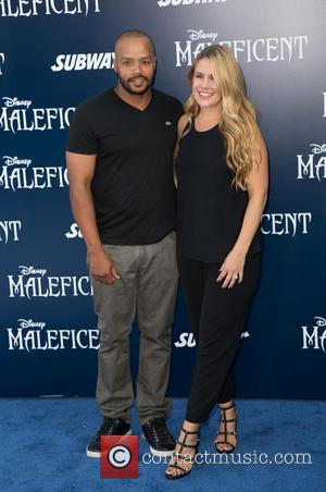 Donald Faison and Cacee Cobb - World Premiere of Disney's 'Maleficent' held at the El Capitan Theatre - Arrivals -...