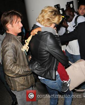 Charlize Theron, Sean Penn and Jackson - Charlize Theron with Sean Penn and son Jackson at Los Angeles International Airport...