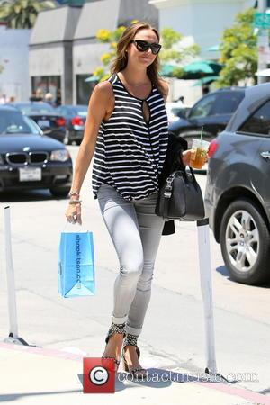 Stacy Keibler - Stacy Keibler seen leaving Urth Cafe carrying a shopping bag from Kitson and an iced tea. -...
