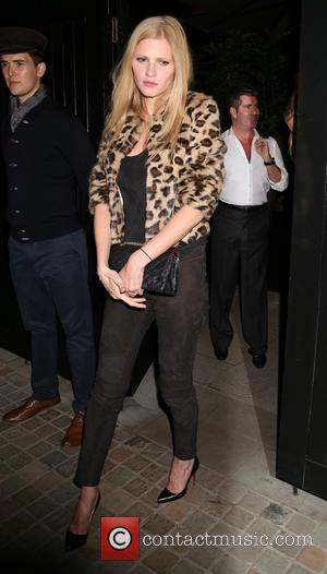 Lara Stone and Simon Cowell