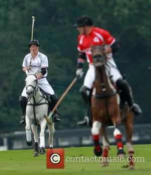 Prince Harry - Prince William Duke of Cambridge and Prince Harry compete in The Audi Polo Challenge at Coworth Park...