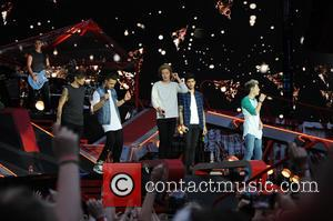 One Direction - One Direction performs at City of Manchester Stadium as part of their 'Where We Are Tour' -...
