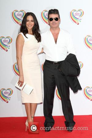 Lauren Silverman and Simon Cowell - Health Lottery VIP Tea Party held at the Savoy Hotel, The Strand, London -...