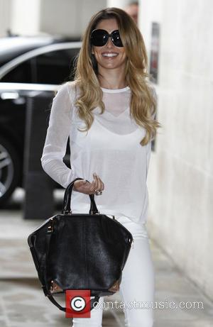 Cheryl Cole - Cheryl Cole arrives at the BBC Radio 1 studios to debut her new single on Nick Grimshaw's...