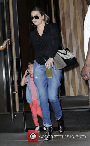 Kourtney Kardashian, Khloe Kardashian and Scott Disick - The Kardashians leaving their Manhattan hotel during filming for their reality show...