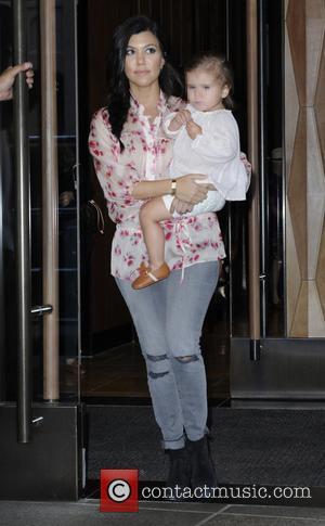 Kourtney Kardashian and Penelope Disick - The Kardashians leaving their Manhattan hotel during filming for their reality show 'Kourtney &...