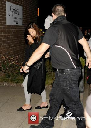 Liam Payne, Sophia Smith and One Direction - One Direction, surrounded by a heavy security team shielding the band from...