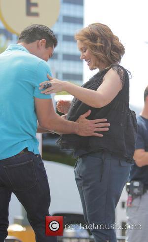 Alyssa Milano and Mario Lopez - Celebrities on TV show 'Exrta' at Universal City - Los Angeles, California, United States...