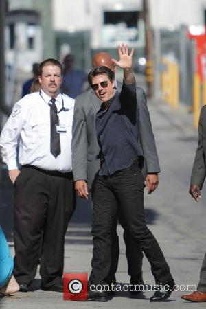 Tom Cruise - Tom Cruise waves to fans and signs autographs as he leaves the Jimmy Kimmel Live! show -...