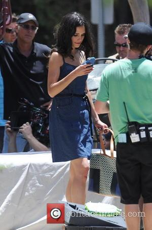 Jordana Brewster - Vin Diesel shows off his biceps while filming an action scene for 'Fast & Furious 7' in...
