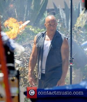 Vin Diesel - Vin Diesel shows off his biceps while filming an action scene for 'Fast & Furious 7' in...