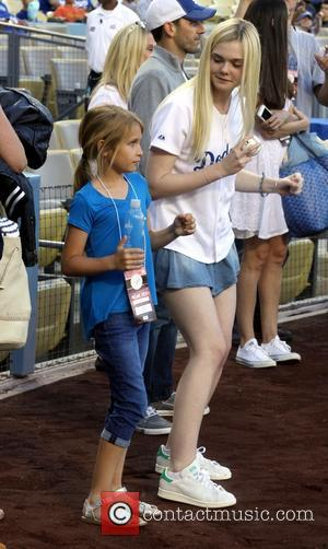 Elle Fanning - Celebrities attend the Los Angeles Dodgers v Chicago White Sox baseball game at Dodger Stadium. The White...
