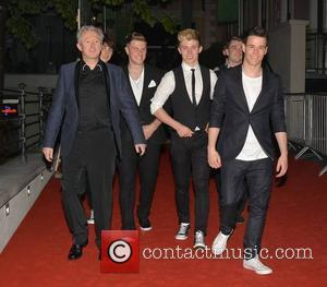 Louis Walsh and Hometown - Pride of Ireland Awards 2014 held at The Mansion House - Departures - Dublin, Ireland...