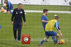Jose Mourinho and Sam Worthington