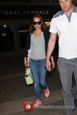Natalie Portman - Natalie Portman and husband Benjamin Millepied with their son Aleph Portman-Millepied at Los Angeles International Airport (LAX)...