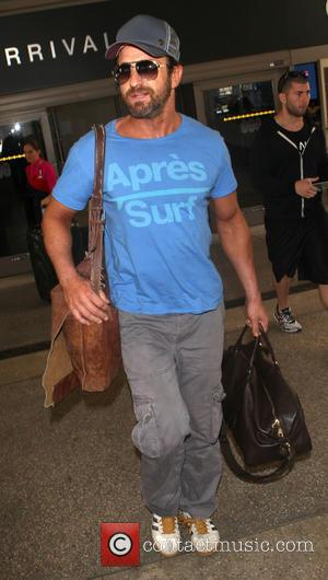 Gerard Butler - Gerard Butler arrives at Los Angeles International (LAX) airport - Los Angeles, California, United States - Thursday...