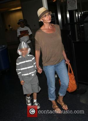 Jaime Pressly and Dezi James Calvo - Jaime Pressly at Los Angeles International Airport (LAX) with her son, Dezi -...