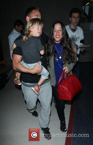Alanis Morissette, Mario Treadway and Ever Morissette-Treadway - Alanis Morissette arrives at Los Angeles International (LAX) airport with husband Mario...