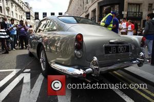 Aston Martin DB5 007 - The 2014 Gumball 3000 arrives on London's Regent Street.  Thousand's of people gathered on...